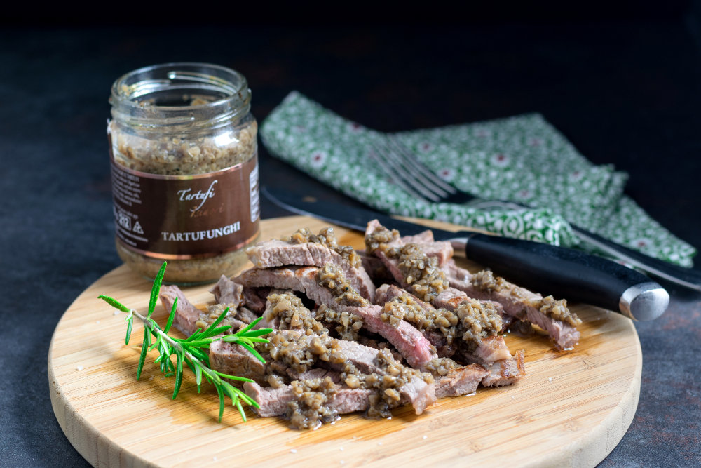 Champignon and truffle sauce on a grilled steak